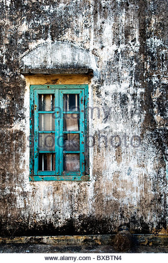 Colourful wooden window on the side of a Hakka village house Hong Kong - Stock Image