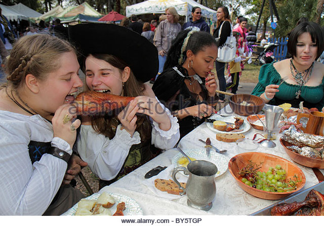 Florida Deerfield Beach Quiet Waters Park Florida Renaissance Festival costume teen girl Black female student turkey - Stock Image