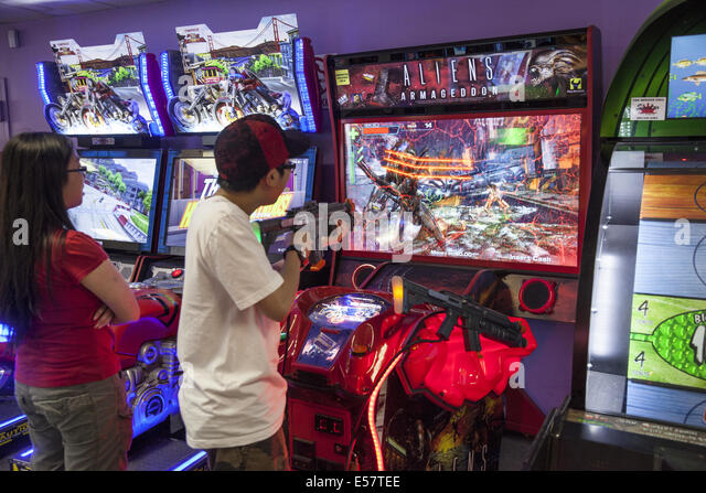 Coney Island; Video game arcades with violent games are popular with with adolescent and teenage boys along with - Stock Image