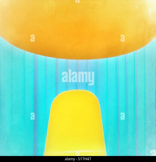 Abstract of yellow chair back, lamp shade and blue blinds - Stock-Bilder