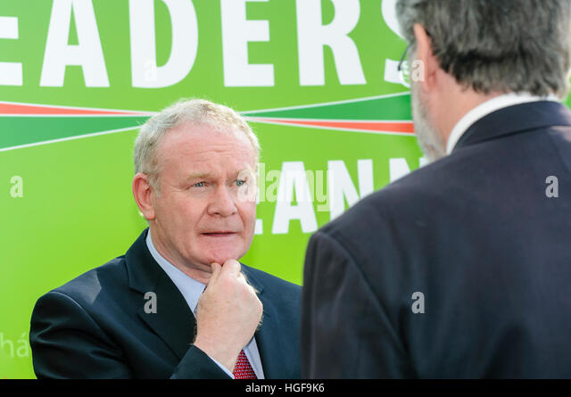Martin McGuinness talks to Gerry Adams. - Stock Image