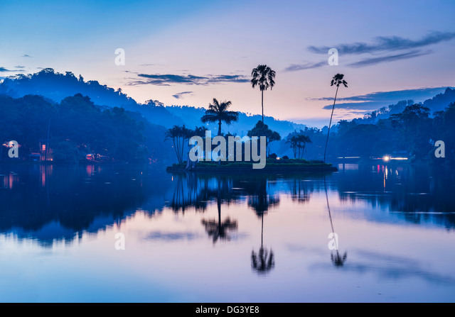 Kandy Lake and the island which houses the Royal Summer House at dawn, Kandy, Central Province, Sri Lanka, Asia - Stock Image