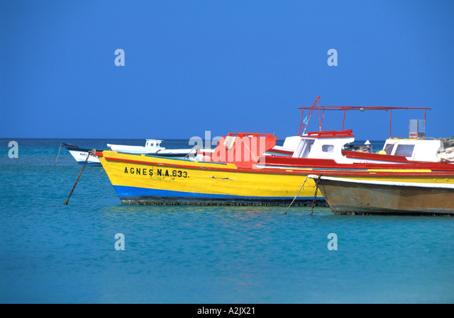 ARUBA Colorful Fishing Boats in bright water - Stock Image