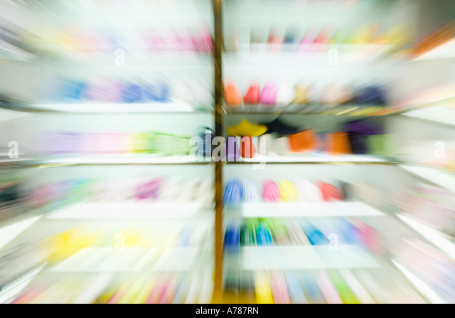 Racks of shoes, blurred - Stock Image