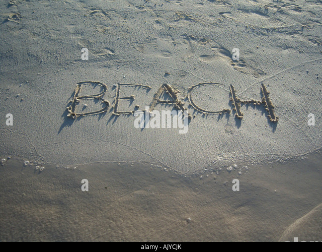 word BEACH on beach scratched  in sand. Photo by Willy Matheisl - Stock Image