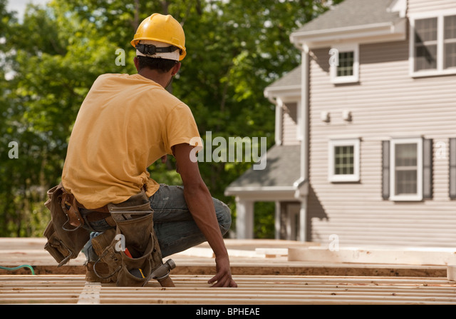 Carpenter at a construction site - Stock Image