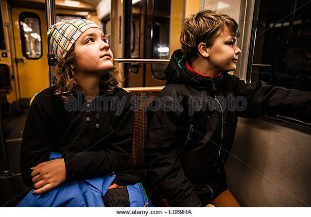 Children traveling in train - Stock Image
