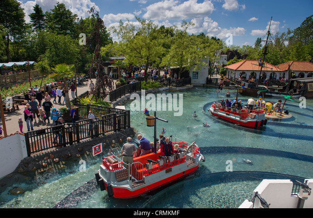 Water fights aboard Lego boats at Pirateland, Legoland, Billund, Denmark - Stock Image