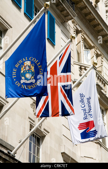 Flags fly / flag flies on offices / Headquarters / head office of The RCN / Royal College of Nursing. Cavendish - Stock Image