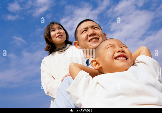 Parents and a boy with blue sky background - Stock-Bilder