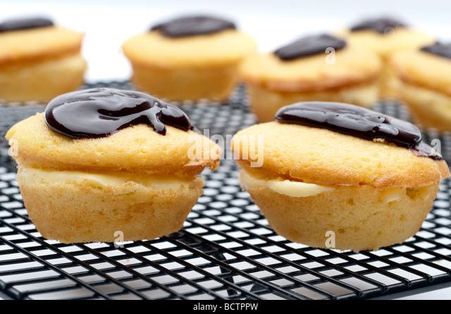horizontal shallow focus close up of a Boston Cream Pie Cupcake - Stock Image