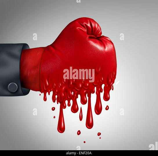 Business pressure and work burnout as a businessperson wearing a red boxing glove that is melting after feeling - Stock Image