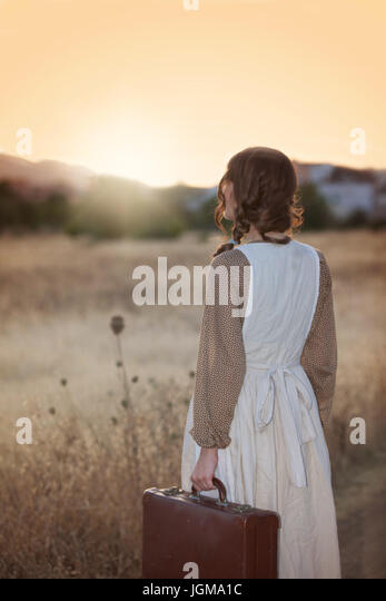 nostalgia, woman leaving home - Stock-Bilder