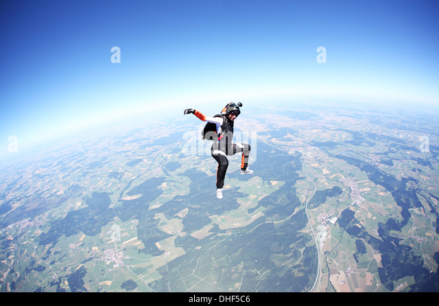 Female skydiver free falling above Leutkirch, Bavaria, Germany - Stock Image