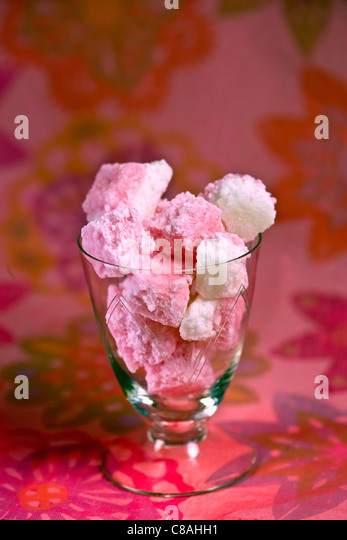 Pink coconut candies - Stock Image