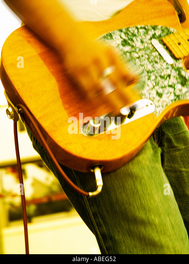 ELECTRIC GUITAR  PLAYING MUSIC IN CONCERT - Stock Image