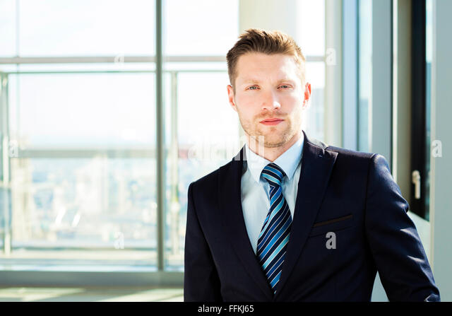 Portrait of well-dressed businessman - Stock Image