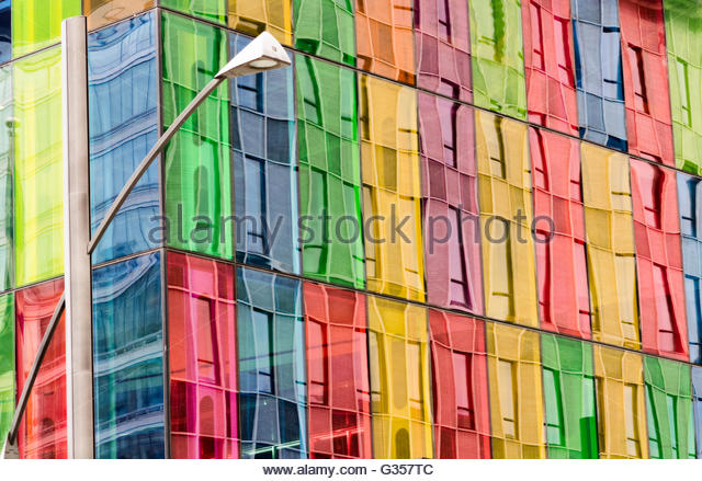 Building facade reflected on colored windows of Montreal Convention center - Stock Image