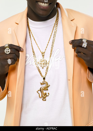 bling rap artist's chest with jewellery - Stock-Bilder