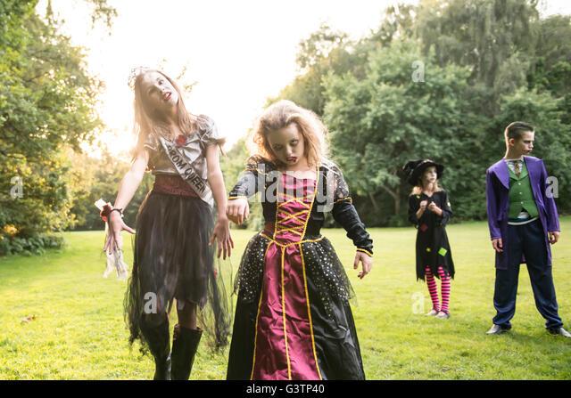 Two children dressed in costume for Halloween Night. - Stock-Bilder