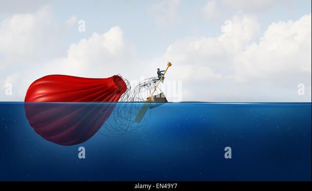Problem Manager as a businessman in the water with a sunk hot air balloon paddling the failed vehicle towards a - Stock Image
