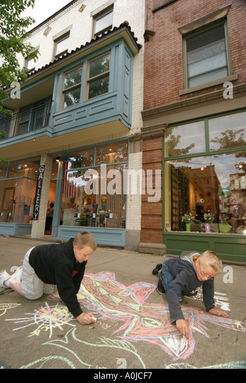 Cleveland Ohio Tremont Artwalk sidewalk chalk drawings boys friends art - Stock Image