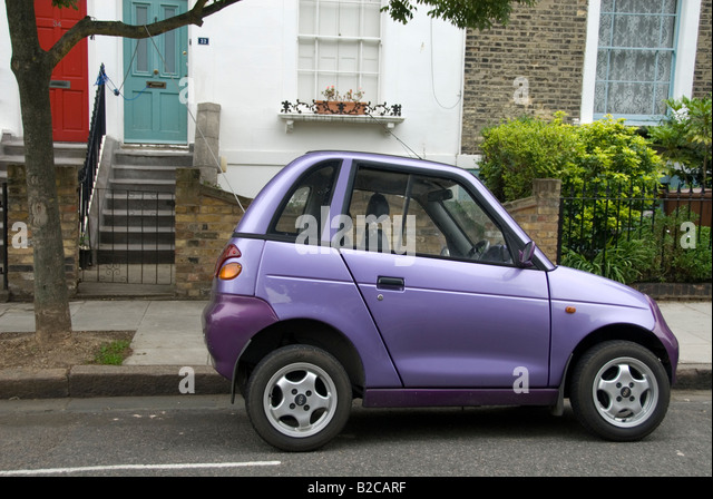 Hackney East London An electric car being charged overnight with lead going from car to home - Stock Image