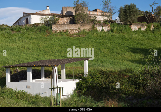Public laundry build in 1988 and water wheel Ferrobo Sao Bras de Alportel Algarve Portugal Mediterranean Europe - Stock Image