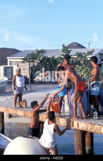 Los Roques Archipelago Venezuela Gran Roque filling water jugs - Stock Image