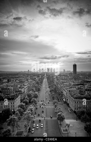Av. de la Grande Armee, Paris, France. View from the top of the Arc de Triomphe; sunset. - Stock Image