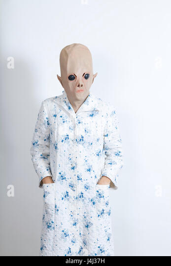 Alien difficult to wake in the morning dressing-up clothes and conceptual parody - Stock Image