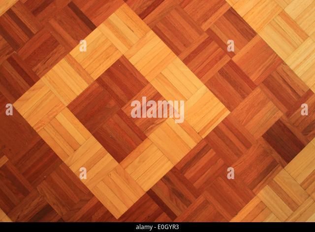 Teakwood floor of quadratic sticks forming two quadrants - Stock-Bilder