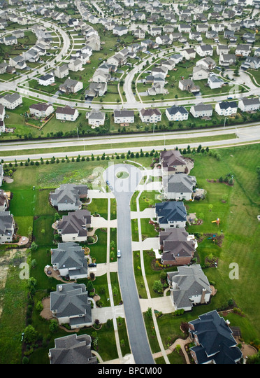 Aerial picture of rows of identical suburban homes in a subdivision in cloudy / wet weather - Stock Image