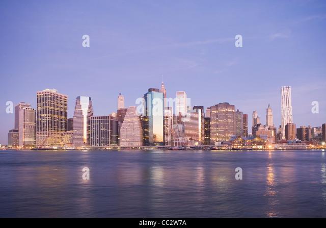 USA, New York State, New York City, City skyline at dusk - Stock Image
