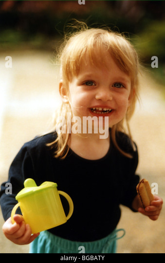 Photograph of girl nursery drinking kids cup non spill healthy - Stock-Bilder