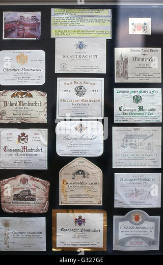 wine bottle labels of famous winery vintages from Chassagne Montrachet Burgundy France - Stock Image