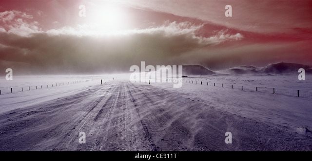 dramatic scene of a freezing Icelandic road and mountains - Stock Image