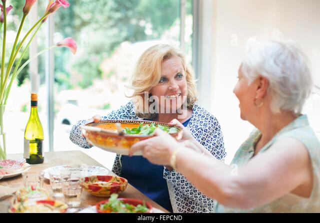 Two women having lunch together, at home - Stock Image