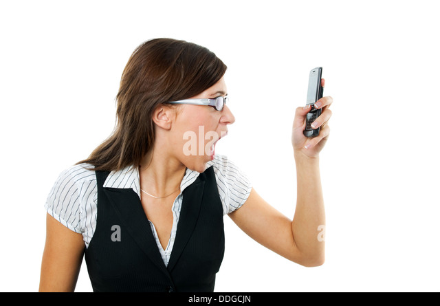 Angry woman shouting at her mobile phone - Stock Image