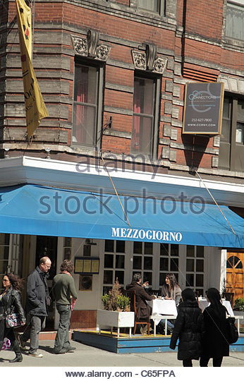 Lower Manhattan New York City NYC NY SoHo Spring Street street scene sidewalk Mezzogiorno Italian restaurant business - Stock Image