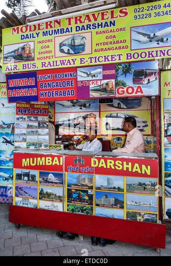 Mumbai India Indian Asian Fort Mumbai Chhatrapati Shivaji Railway Station Terminus Area sidewalk street travel agent - Stock Image