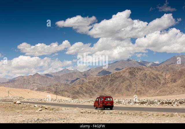 India, Jammu & Kashmir, Ladakh, Stakna, minivan on road through Leh Valley - Stock Image