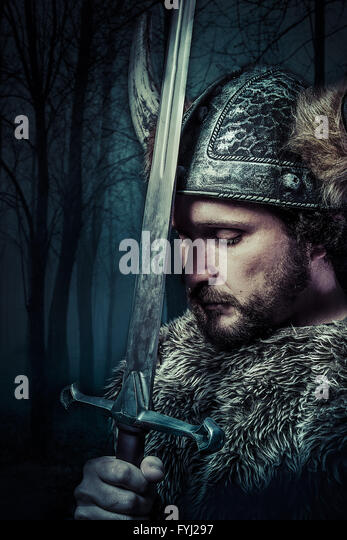 Peace, Viking warrior, male dressed in Barbarian style with sword, bearded - Stock-Bilder