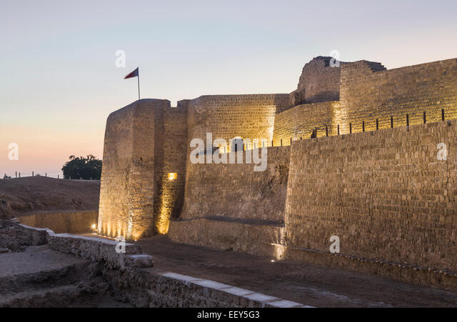 Sunset at Bahrain Fort near Manama at Seef, Bahrain - Stock Image