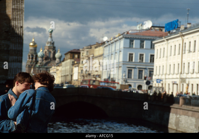 Russia former Soviet Union St. Petersburg Griboedov Canal romantic couple Nevsky Prospeckt Church on Savior's - Stock Image