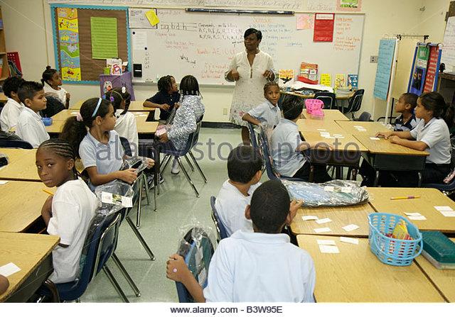 Miami Florida Comstock Elementary School Hispanic Black woman boy boys girl girls child children student teacher - Stock Image
