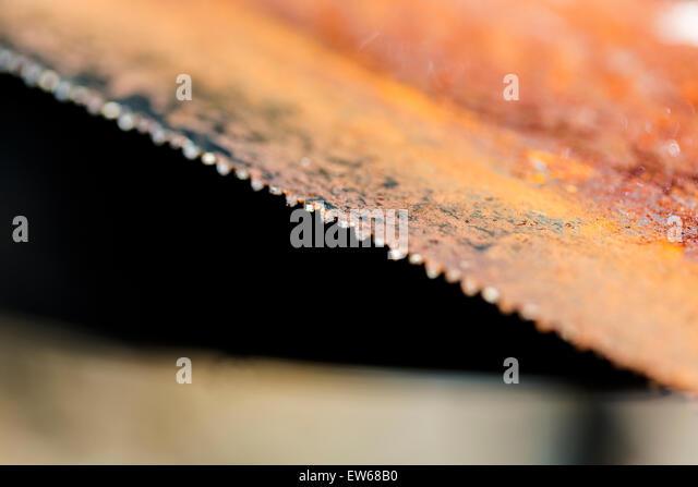Red Rusty Steel Saw Blade  teeth - Stock Image