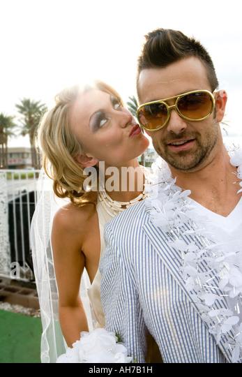 Bride standing beside a groom and puckering - Stock-Bilder