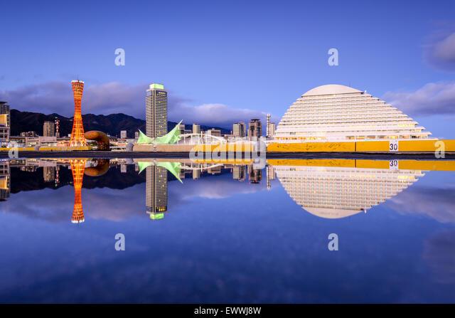 Kobe, Japan skyline with puddle reflections. - Stock Image