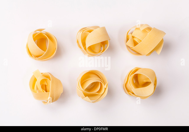 Spilled raw pappardelle pasta - Stock Image